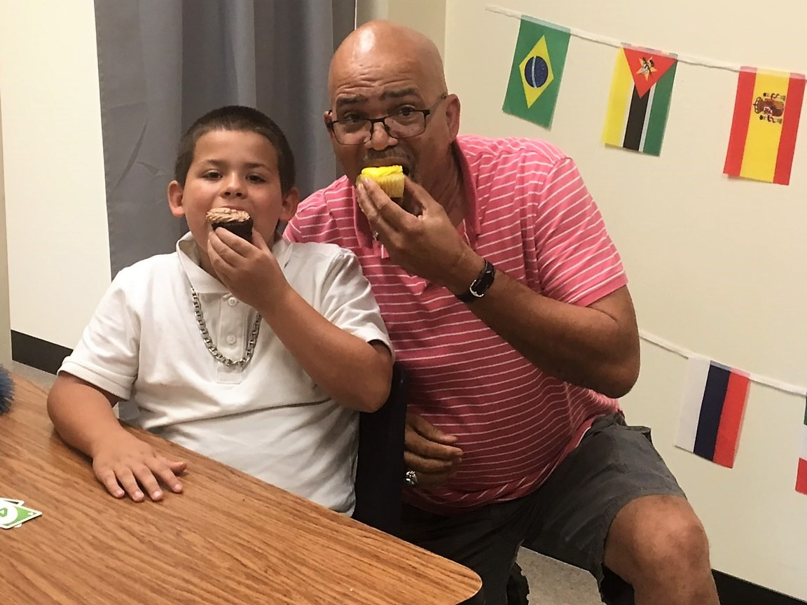 Stony Point Pastor Dexter Sharing A Cupcake With Lunch Buddy