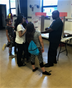 Eugene Ware Mark Reeves Helping Girl Scouts With First Aid And Cpr (5)